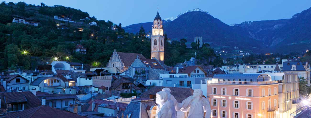 Merano at night with view of the steeple of the cathedral