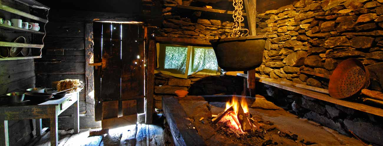The kitchen with an open hearth for cooking in an old farm in South Tyrol