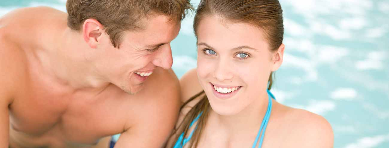 Smiling couple in the swimming pool